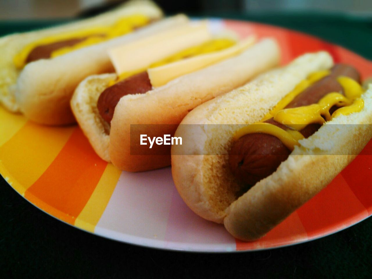 Hot dogs served in plate on table
