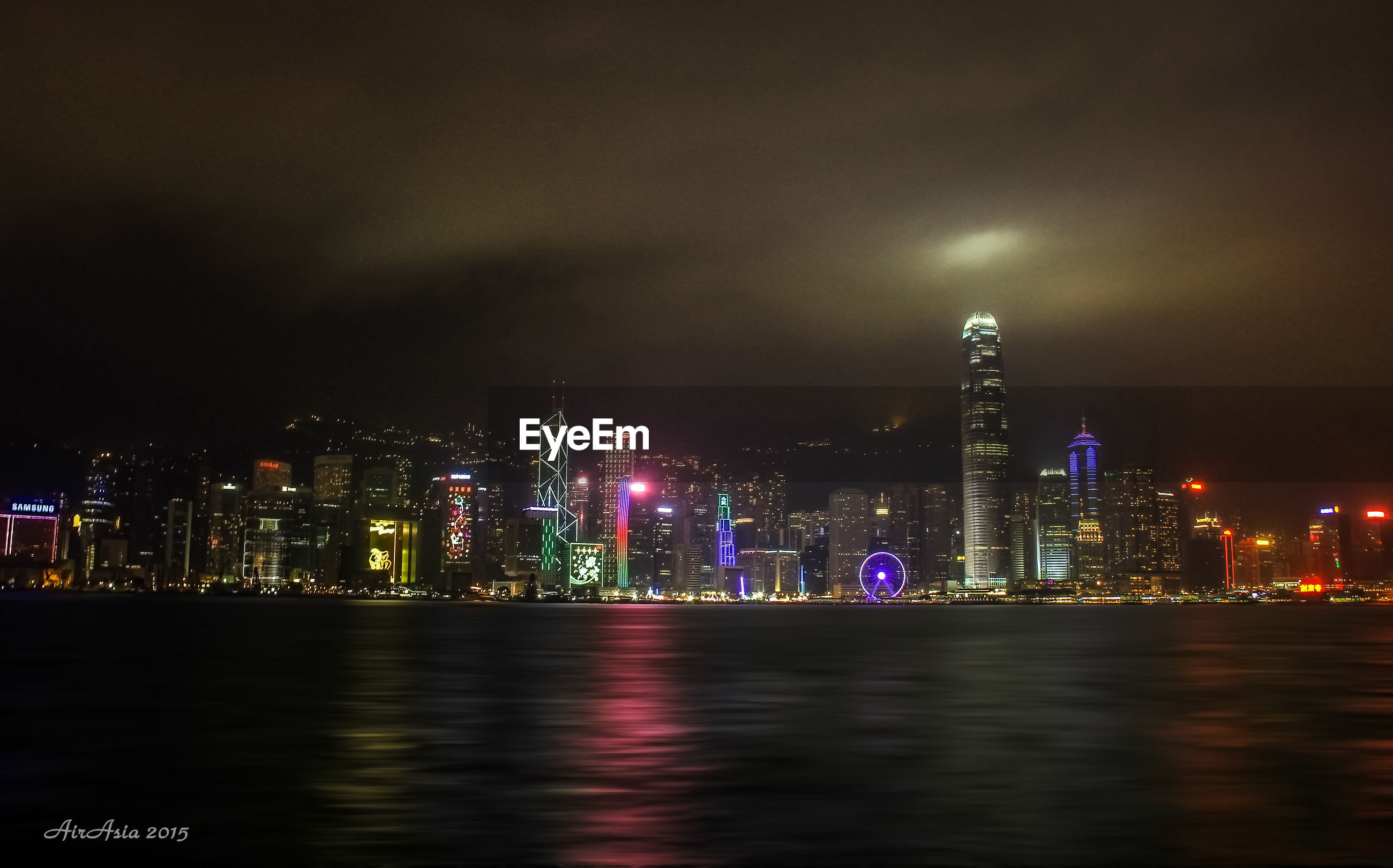 illuminated, night, city, building exterior, architecture, skyscraper, built structure, cityscape, modern, tall - high, waterfront, water, tower, office building, urban skyline, sky, financial district, river, reflection, capital cities