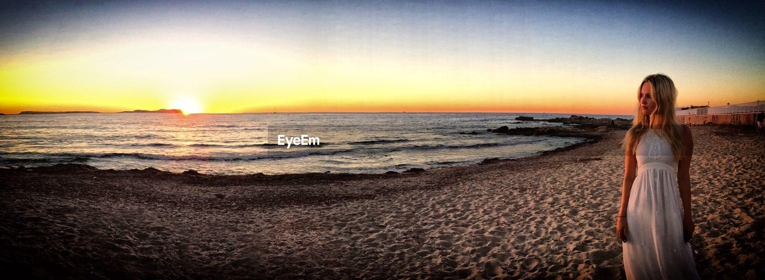sea, horizon over water, beach, sunset, water, scenics, shore, beauty in nature, orange color, tranquil scene, tranquility, sun, sand, wave, idyllic, nature, sky, clear sky, coastline, sunlight