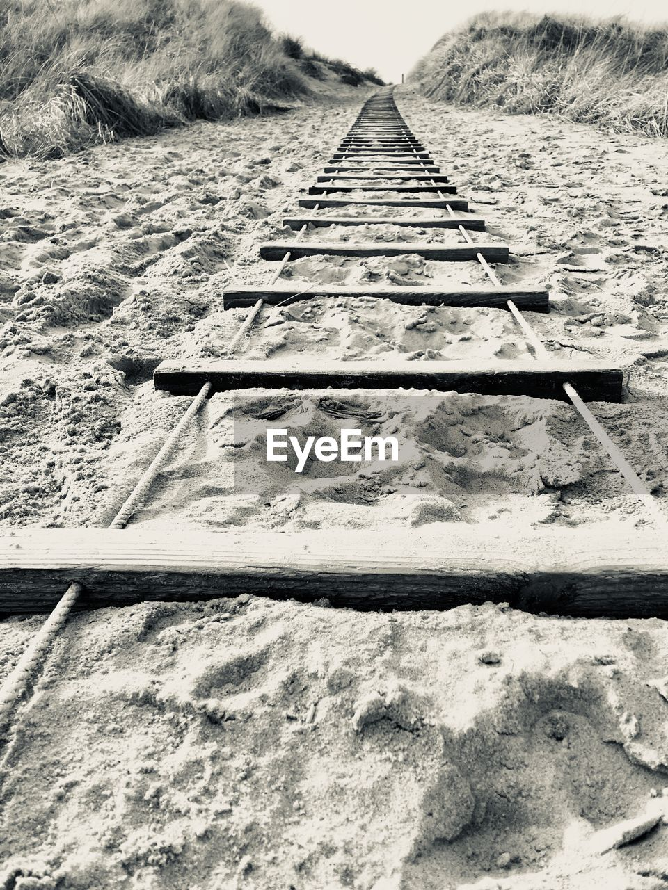 outdoors, railroad track, day, no people, the way forward, nature, sand, tire track, sky