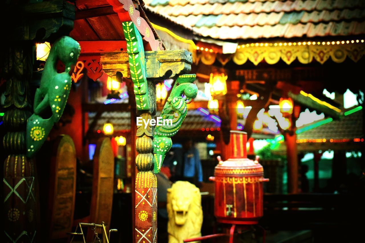 illuminated, multi colored, no people, spirituality, night, place of worship, architecture, indoors, statue, sculpture, building exterior, dragon, close-up, chinese dragon