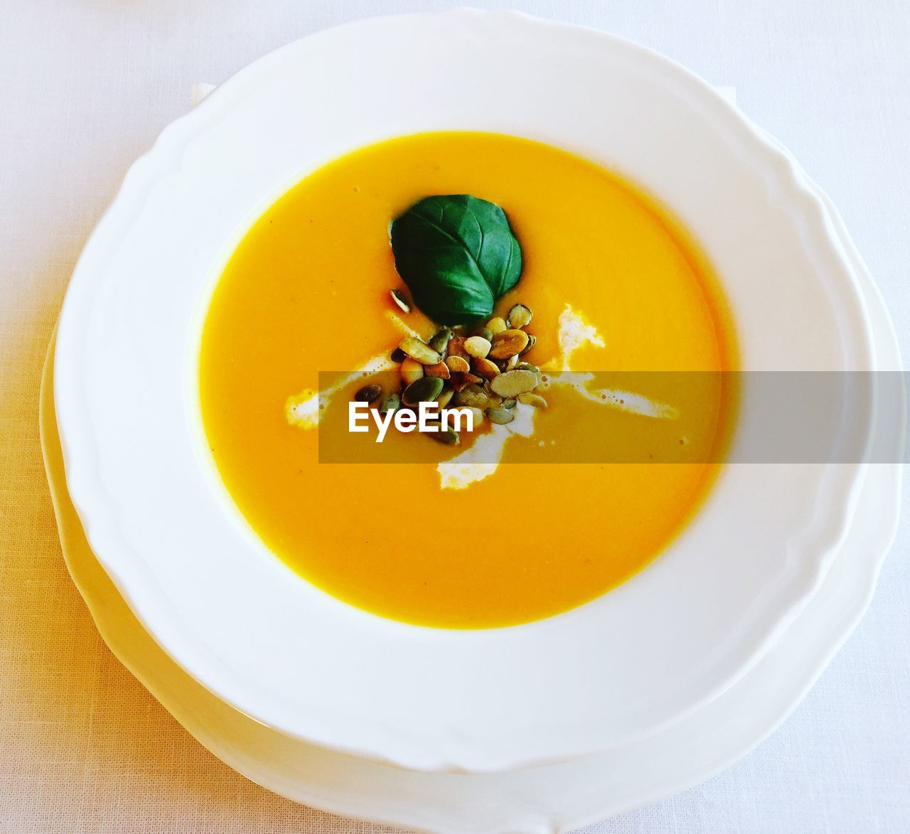High angle view of pumpkin soup in plate on table