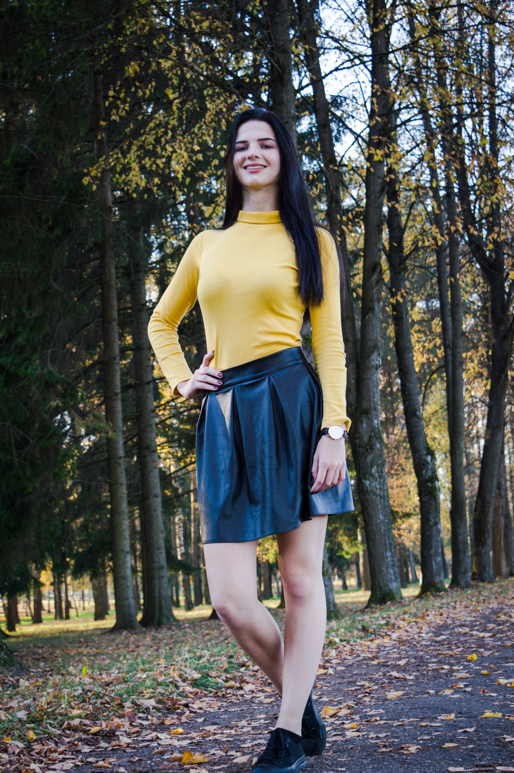 Portrait of beautiful woman standing at park