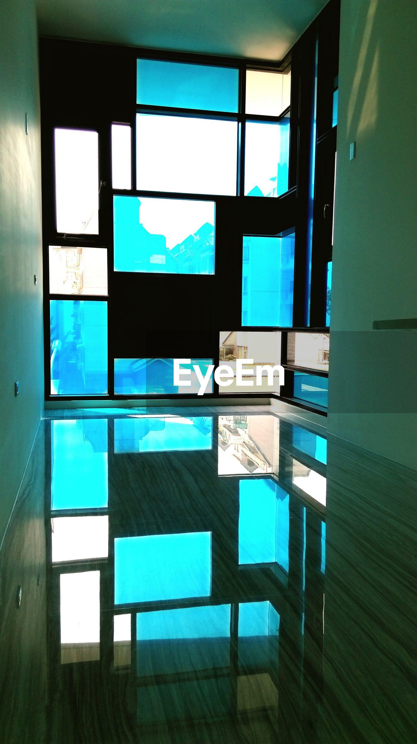 Reflection of window on tiled floor