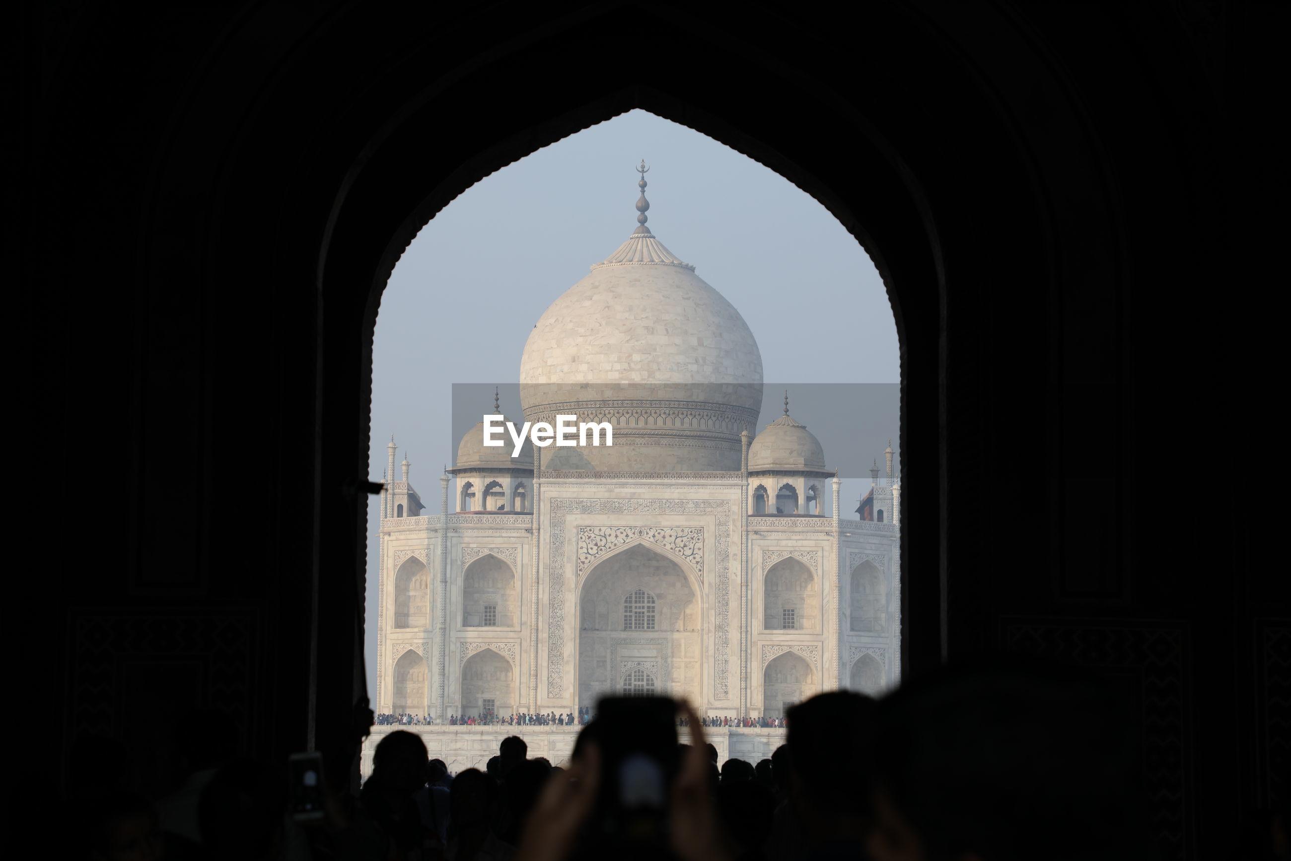 Taj mahal seen from archway
