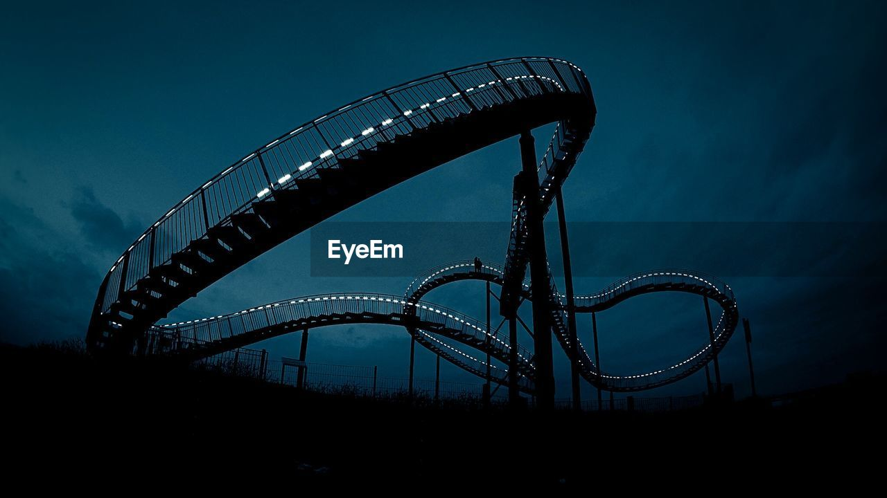 Low Angle View Of Silhouette Rollercoaster Against Sky At Dusk