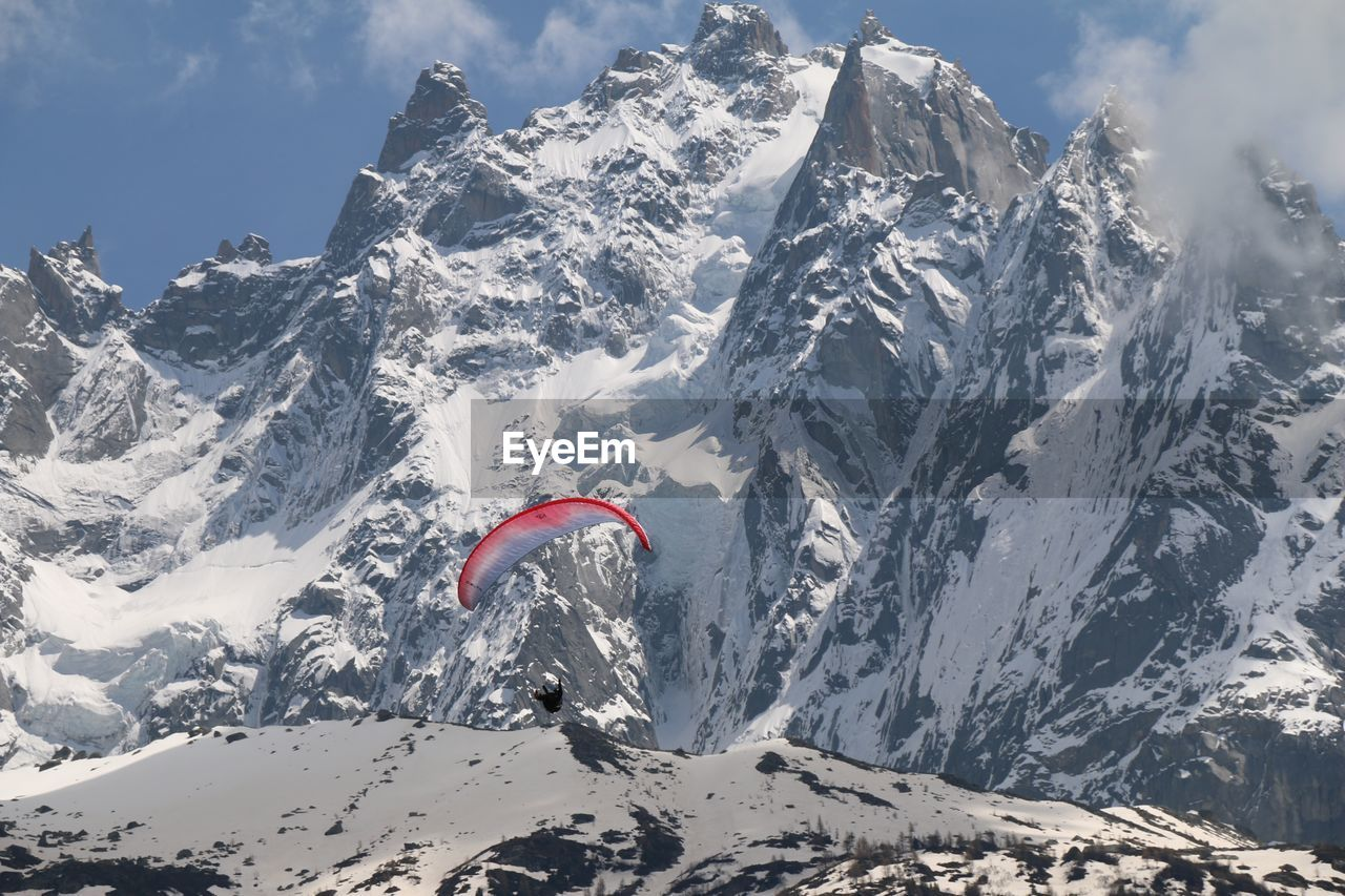 mountain, snow, winter, scenics - nature, beauty in nature, cold temperature, mountain range, snowcapped mountain, sky, day, sport, adventure, non-urban scene, tranquil scene, nature, flying, environment, extreme sports, mid-air, formation