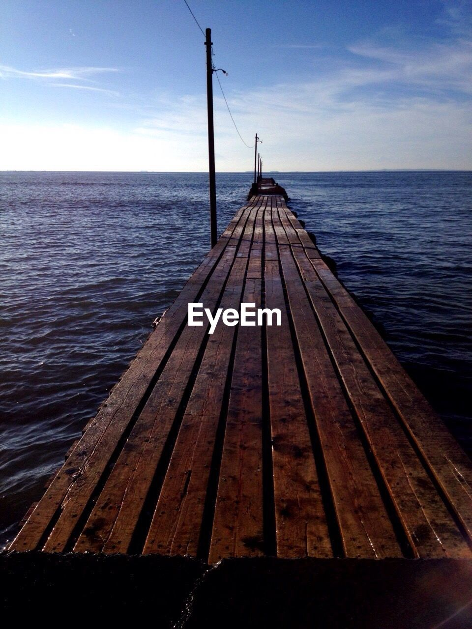 water, sea, wood - material, horizon over water, nature, scenics, pier, no people, sky, beauty in nature, tranquil scene, jetty, tranquility, rippled, outdoors, wood paneling, day, close-up