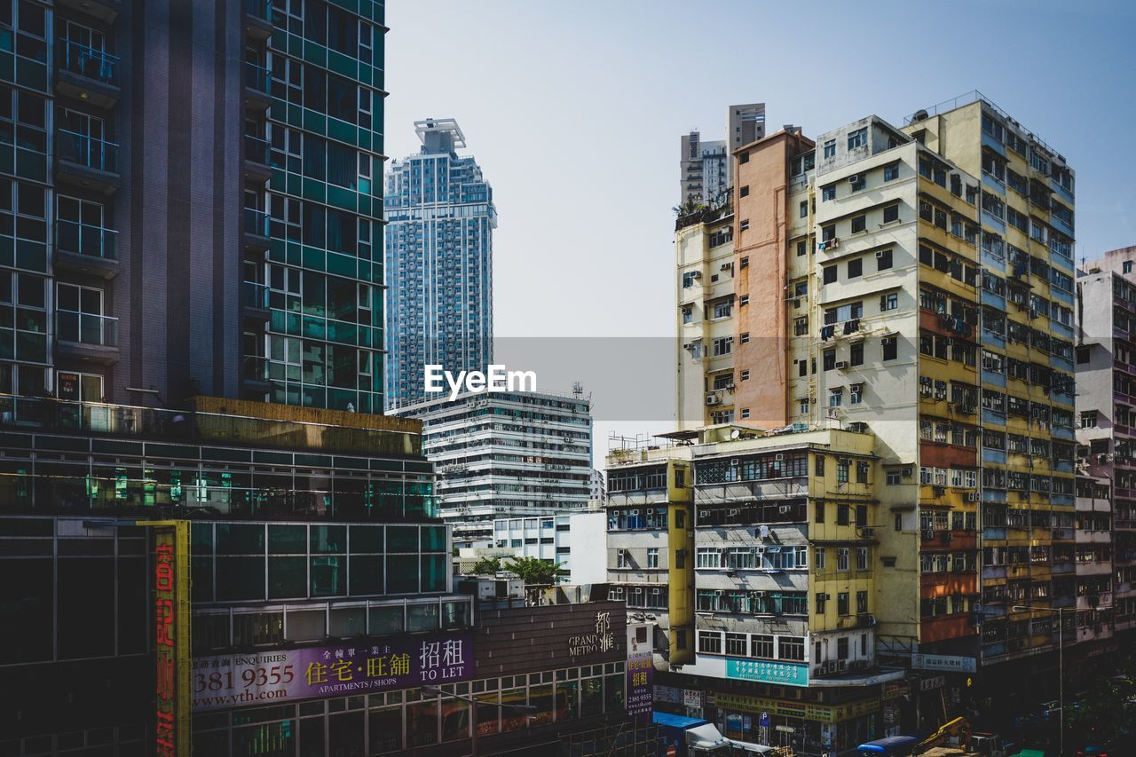 building exterior, built structure, architecture, building, city, sky, day, no people, residential district, tall - high, nature, office building exterior, modern, outdoors, office, window, tower, clear sky, city life, skyscraper, apartment, financial district