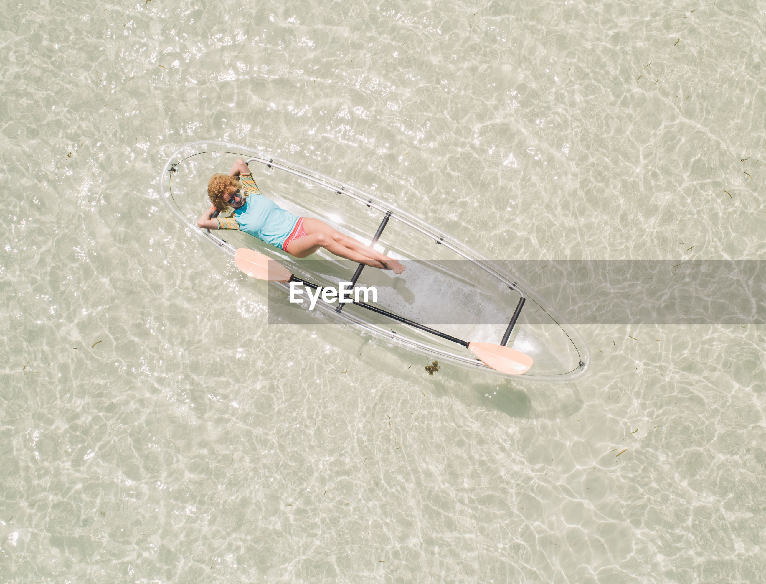 HIGH ANGLE VIEW OF MAN LYING ON SWIMMING POOL
