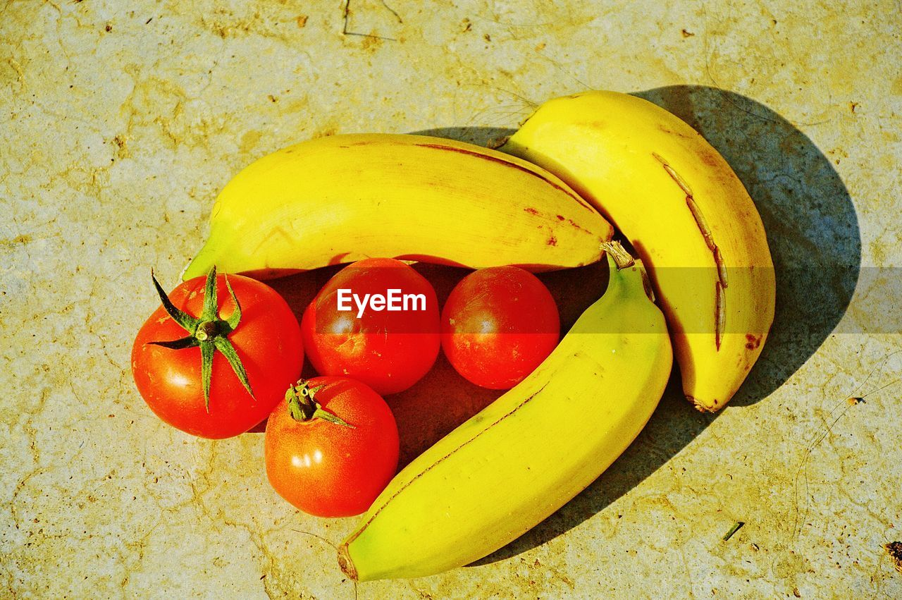 food and drink, food, yellow, healthy eating, fruit, freshness, banana, vegetable, no people, high angle view, tomato, indoors, red, close-up, day