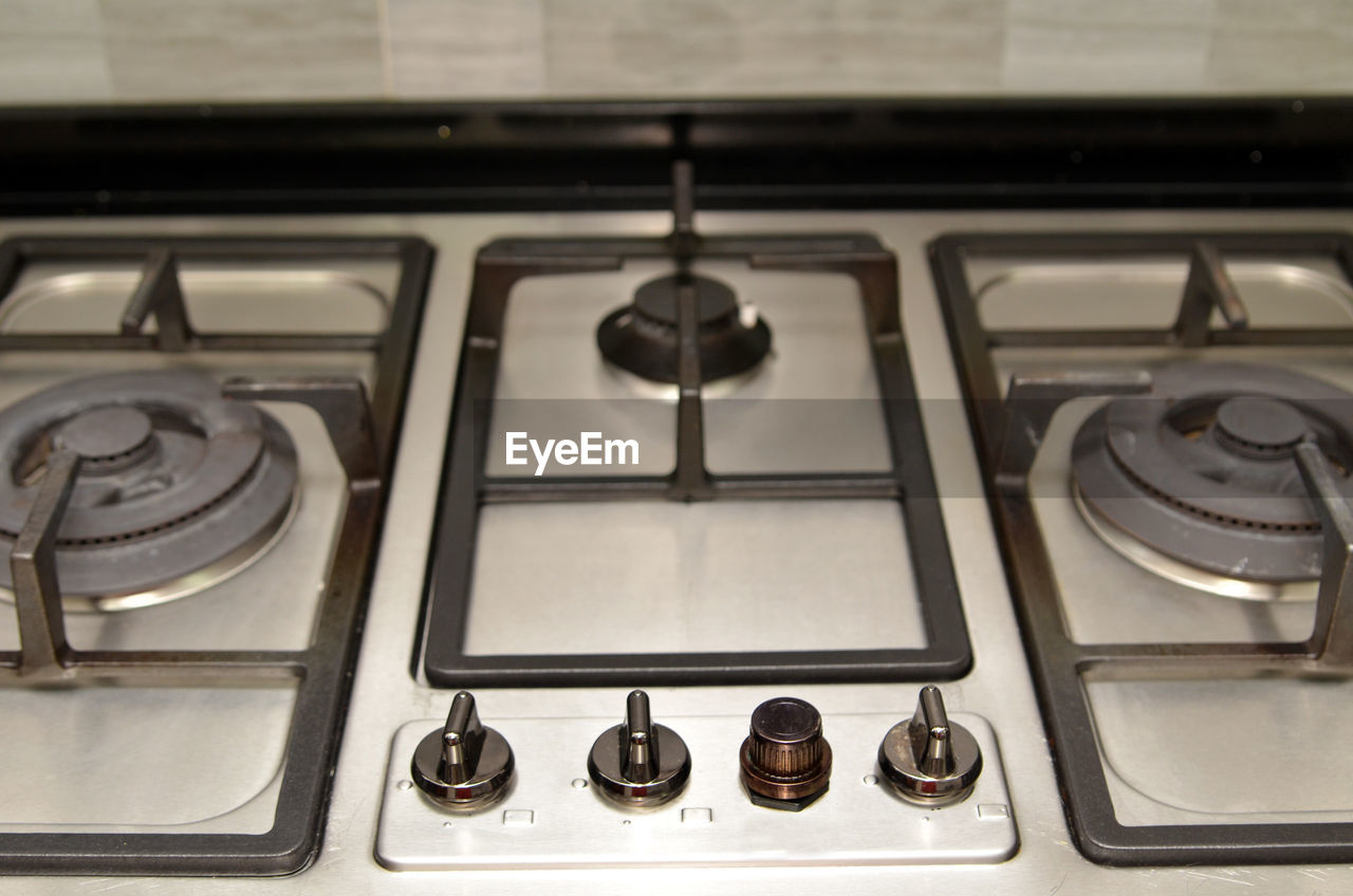 control, domestic kitchen, stove, knob, burner - stove top, indoors, control panel, no people, close-up, day