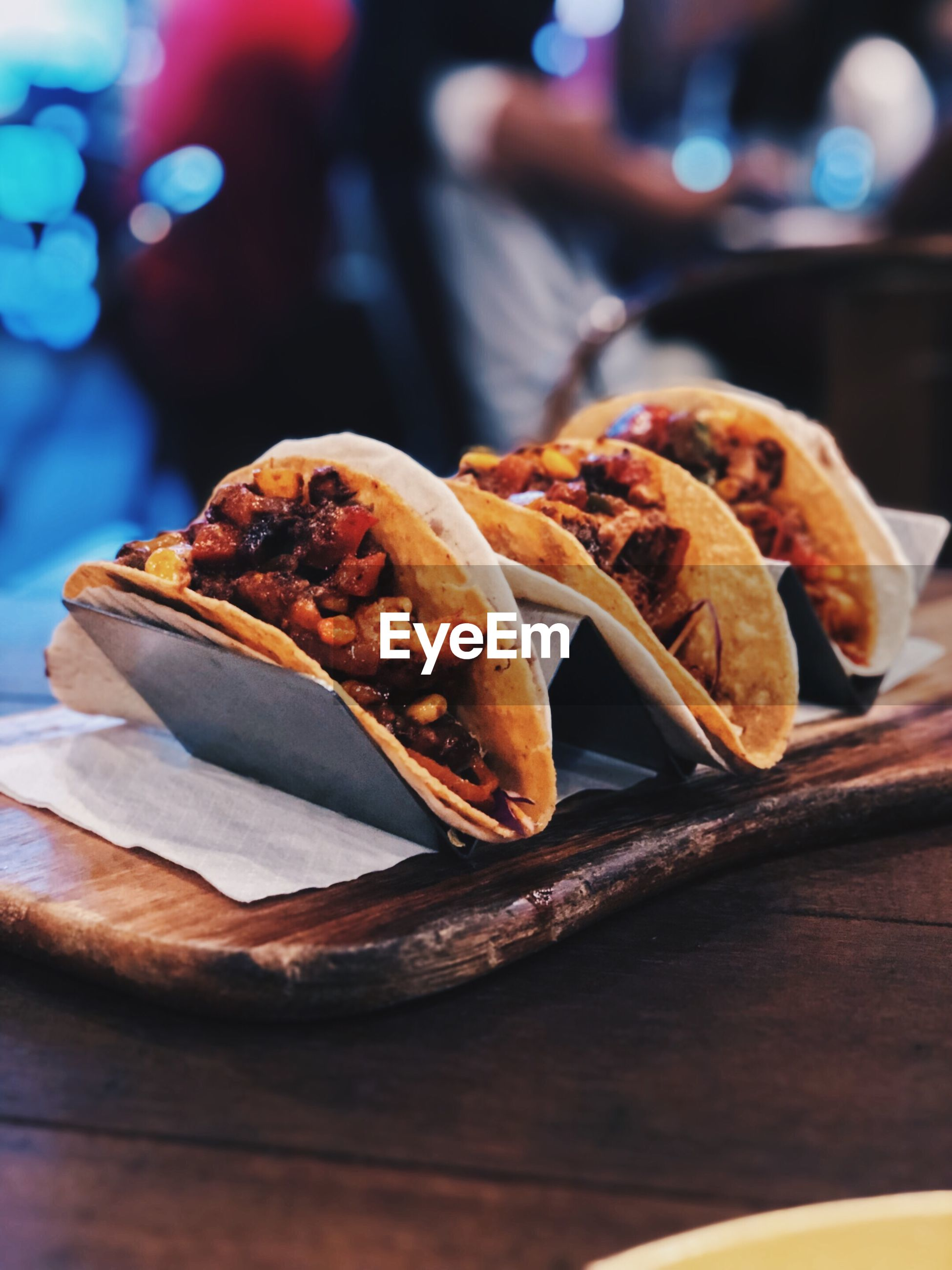 Close-up of tacos in tray on table
