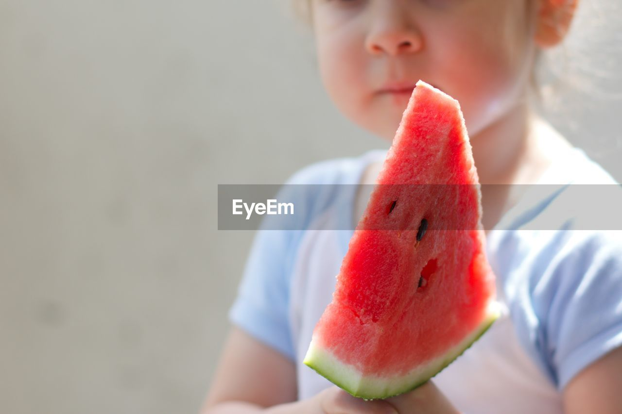 Close-Up Of Child With Watermelon Slice