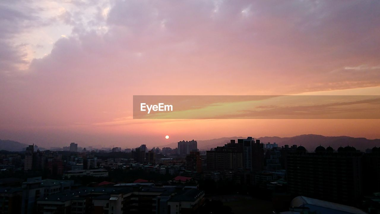architecture, building exterior, sunset, built structure, cityscape, sky, no people, city, residential building, outdoors, residential, nature, day