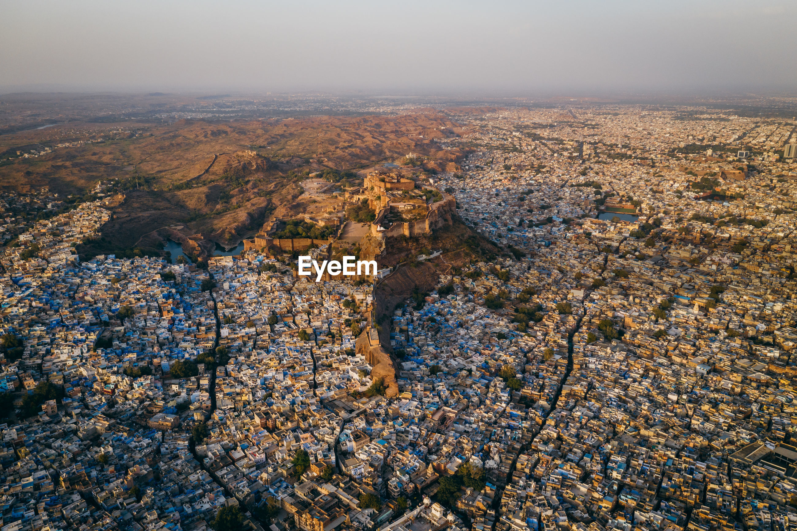 HIGH ANGLE VIEW OF CITYSCAPE AND LAND
