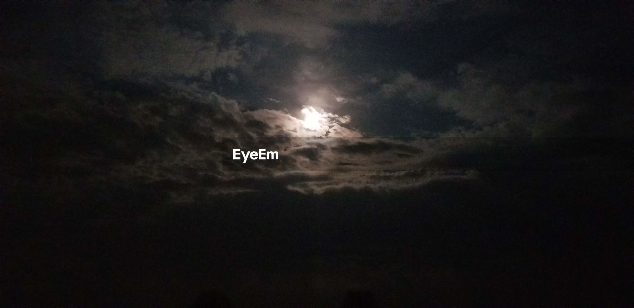 sky, cloud - sky, beauty in nature, scenics - nature, low angle view, night, tranquility, nature, moon, tranquil scene, no people, dark, space, idyllic, overcast, outdoors, astronomy, cloudscape, storm, moonlight, planetary moon, ominous