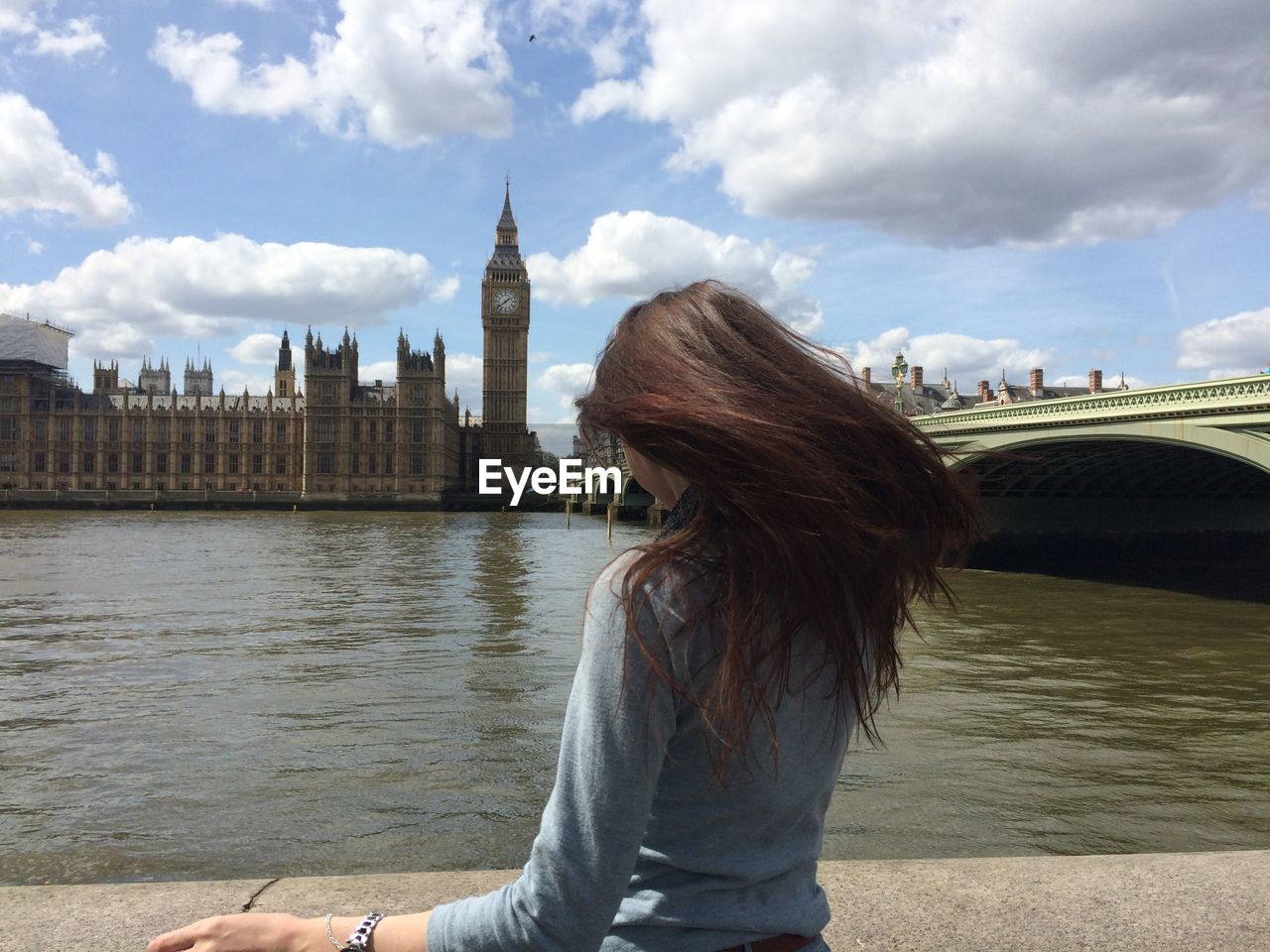 Rear view of woman looking at big ben tower against sky