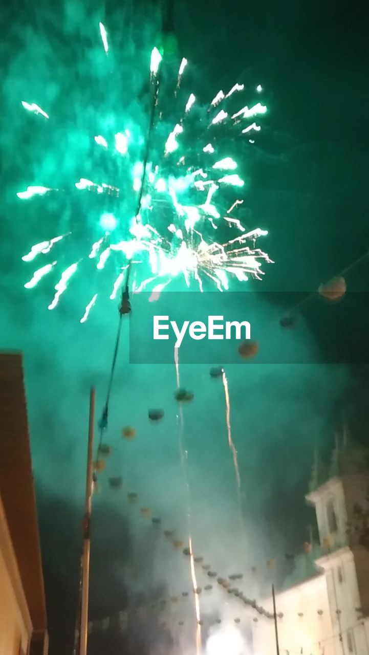 celebration, firework display, firework - man made object, night, smoke - physical structure, illuminated, event, arts culture and entertainment, no people, traditional festival, firework, outdoors, low angle view, close-up, sky