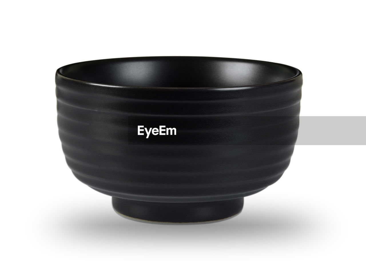 Close-up of black bowl against white background
