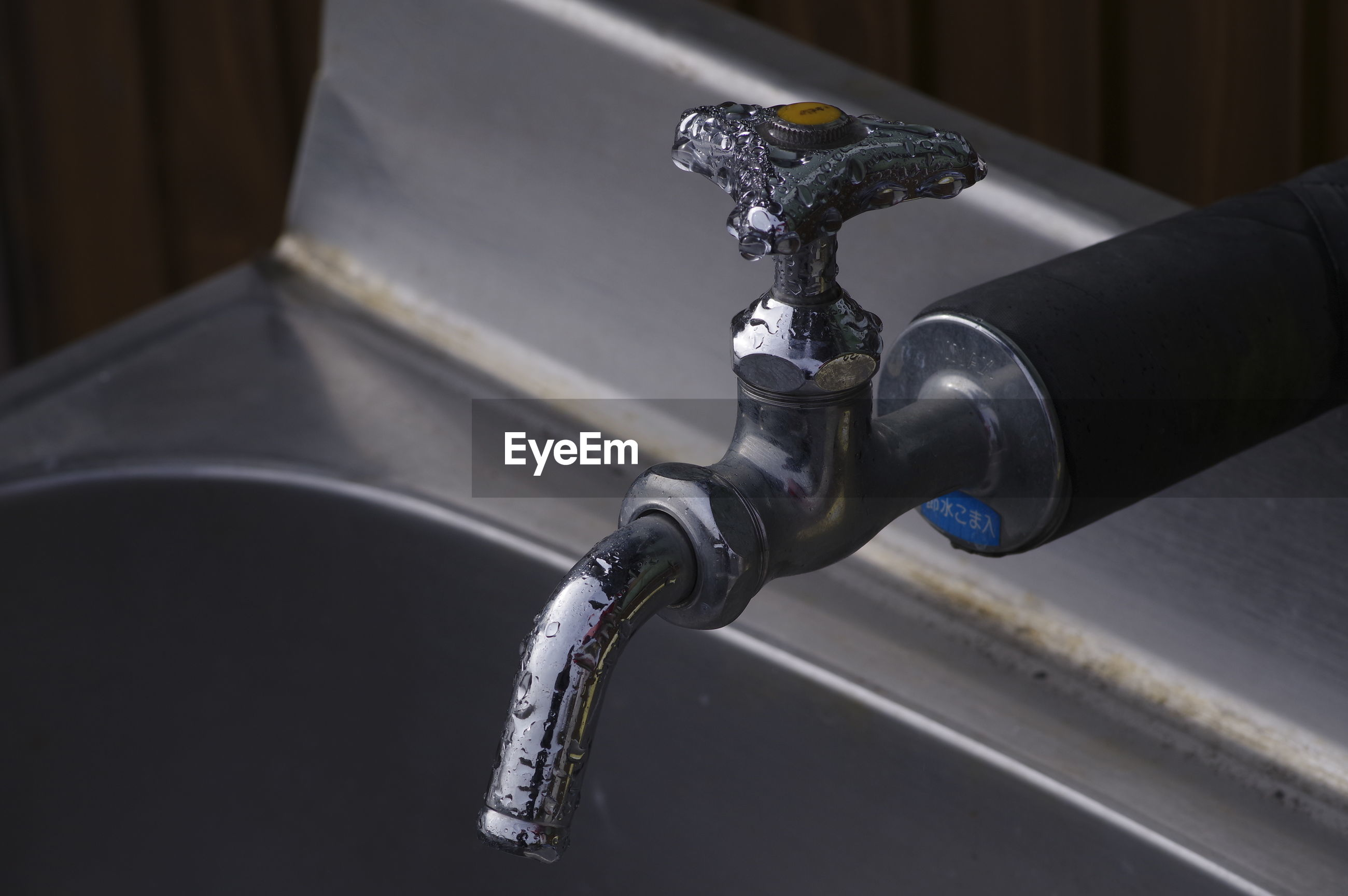 High angle view of faucet in bathroom
