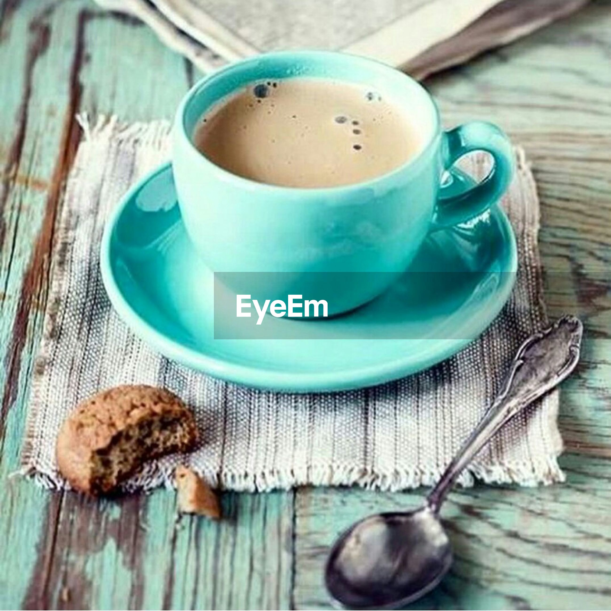 food and drink, table, indoors, coffee cup, still life, freshness, coffee - drink, drink, refreshment, wood - material, spoon, high angle view, saucer, cup, coffee, food, close-up, wooden, directly above, breakfast