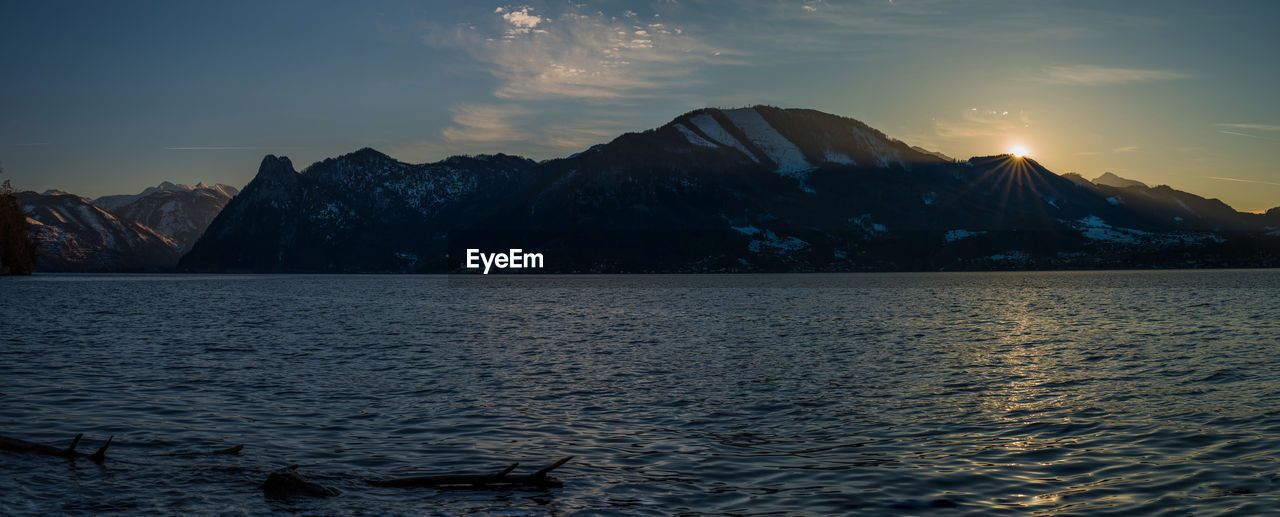 water, mountain, sky, scenics - nature, beauty in nature, tranquility, tranquil scene, sea, sunset, mountain range, nature, waterfront, no people, non-urban scene, cloud - sky, idyllic, rippled, outdoors, remote