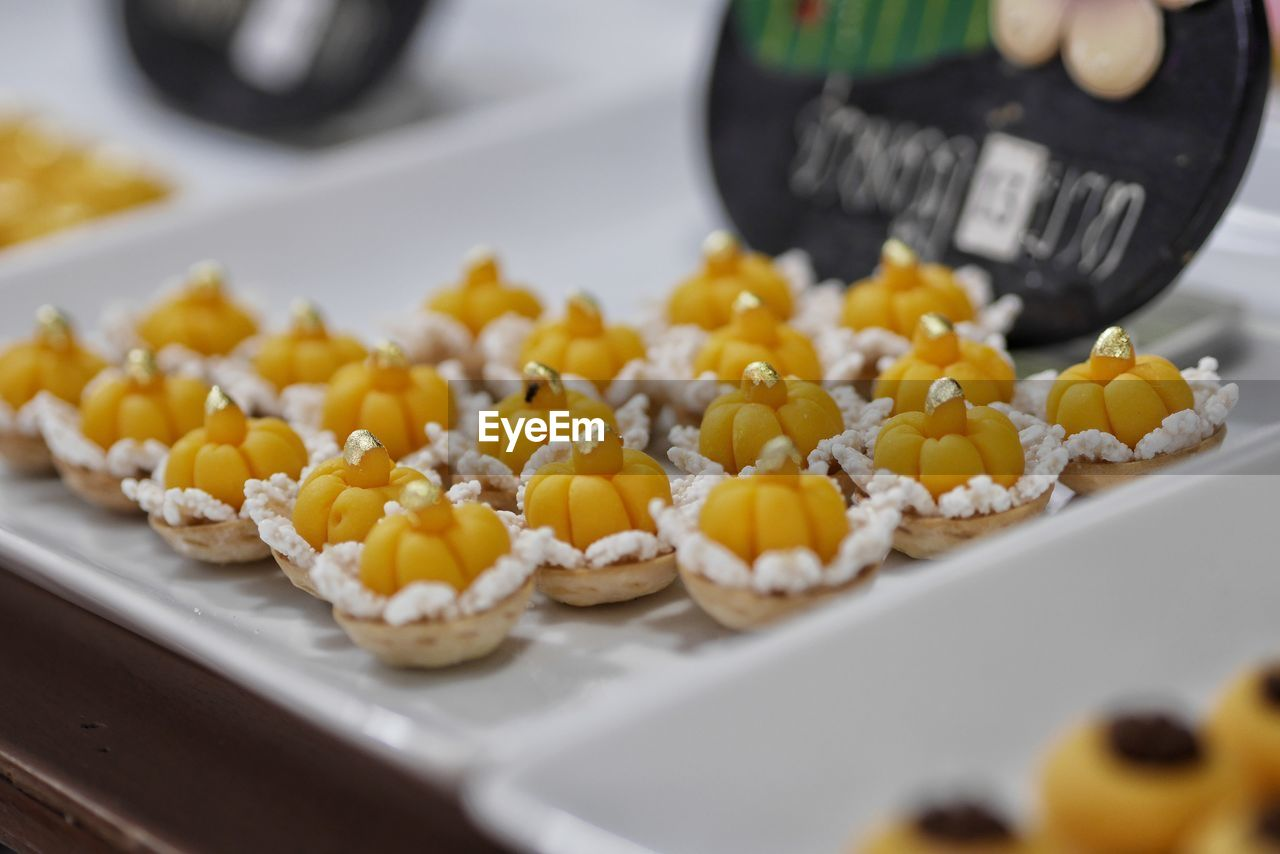 food, food and drink, freshness, selective focus, indoors, still life, close-up, sweet food, no people, indulgence, ready-to-eat, healthy eating, corn, temptation, sweet, yellow, dessert, kitchen utensil, high angle view, vegetable, tray