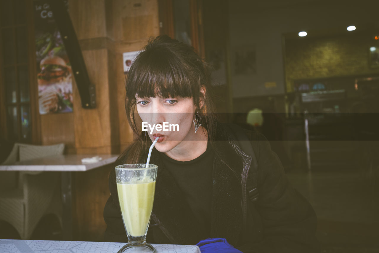 Portrait Of Young Woman Drinking Smoothie