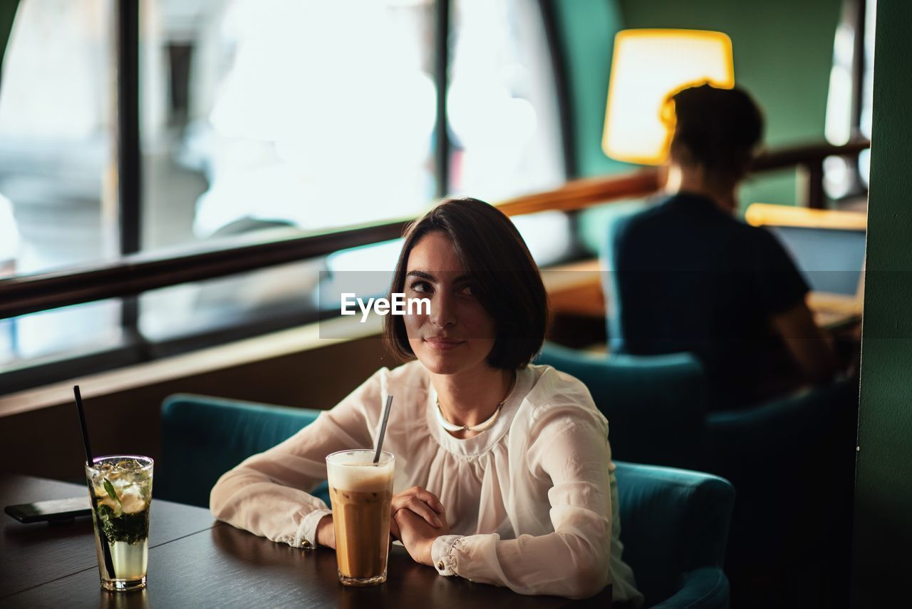 Thoughtful Woman Having Coffee In Cafe