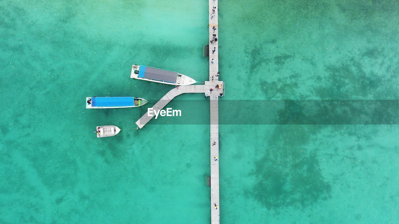 water, day, no people, high angle view, nature, turquoise colored, outdoors, green color, pool, swimming pool, blue, aerial view, communication, waterfront, lake, ladder, absence, directly above, sport