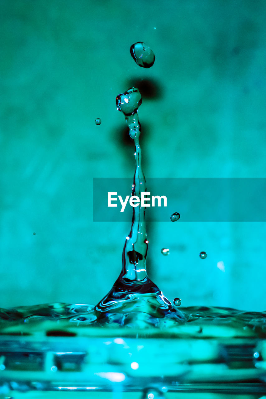 Close-Up Of Water Drop Against Blue Background