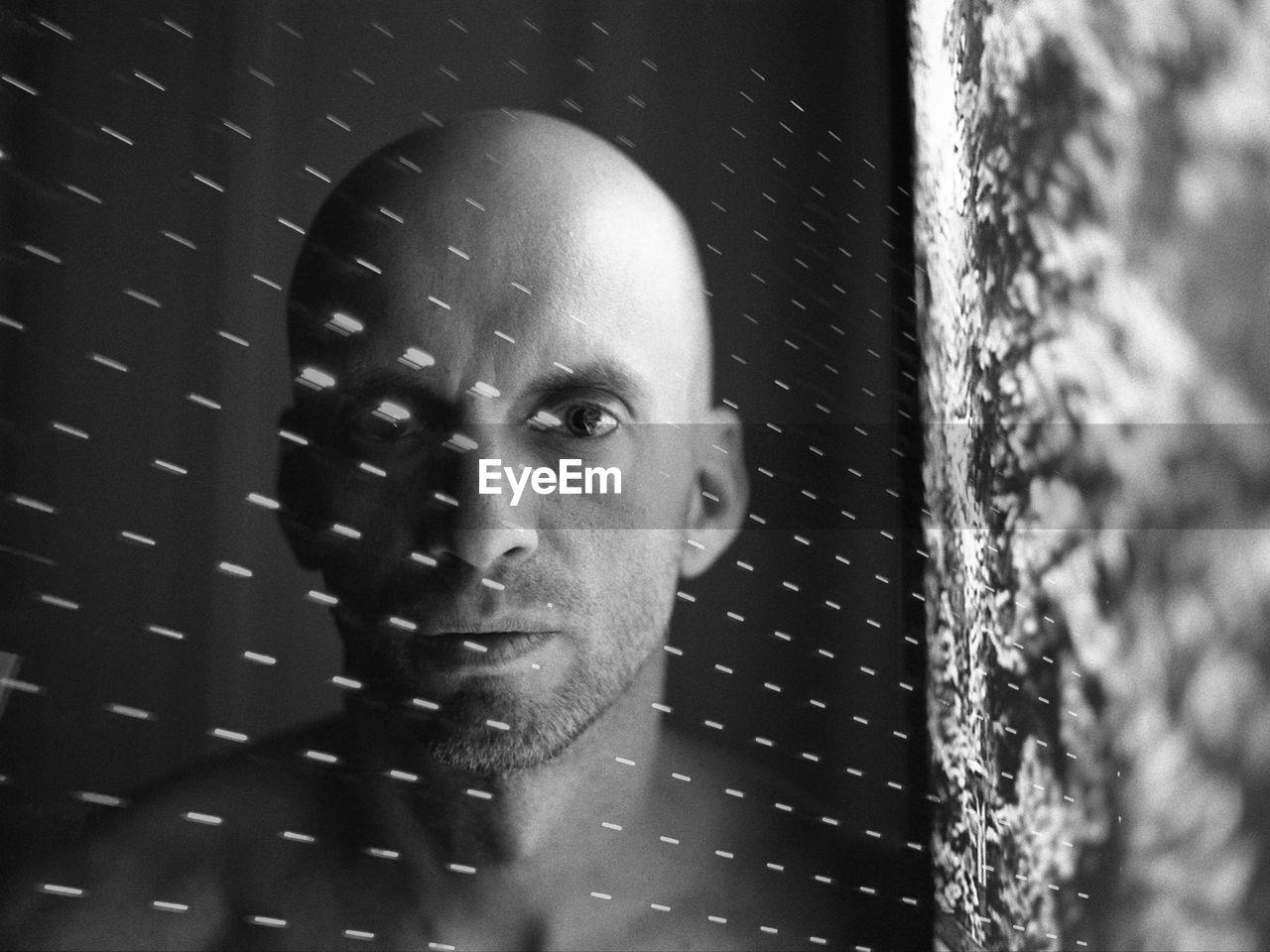 Digital Composite Image Of Bald Man And Light