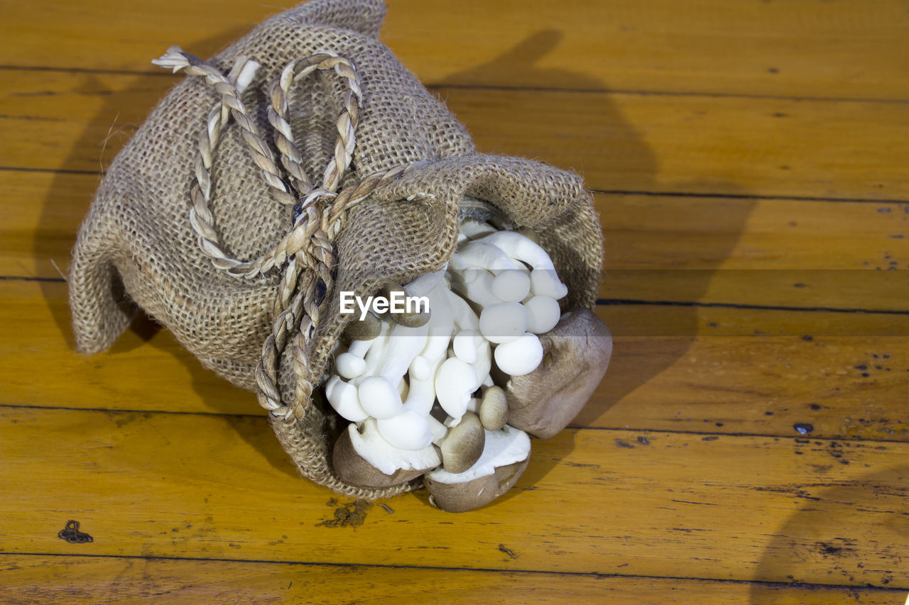 High Angle View Of Mushrooms In Sack