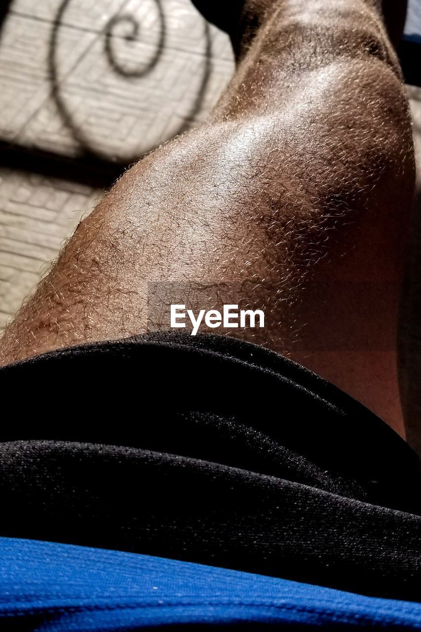 human body part, one person, midsection, lifestyles, adult, indoors, body part, men, close-up, muscular build, sport, healthy lifestyle, strength, real people, clothing, exercising, athlete, sports training, human skin, effort, human limb, weight training