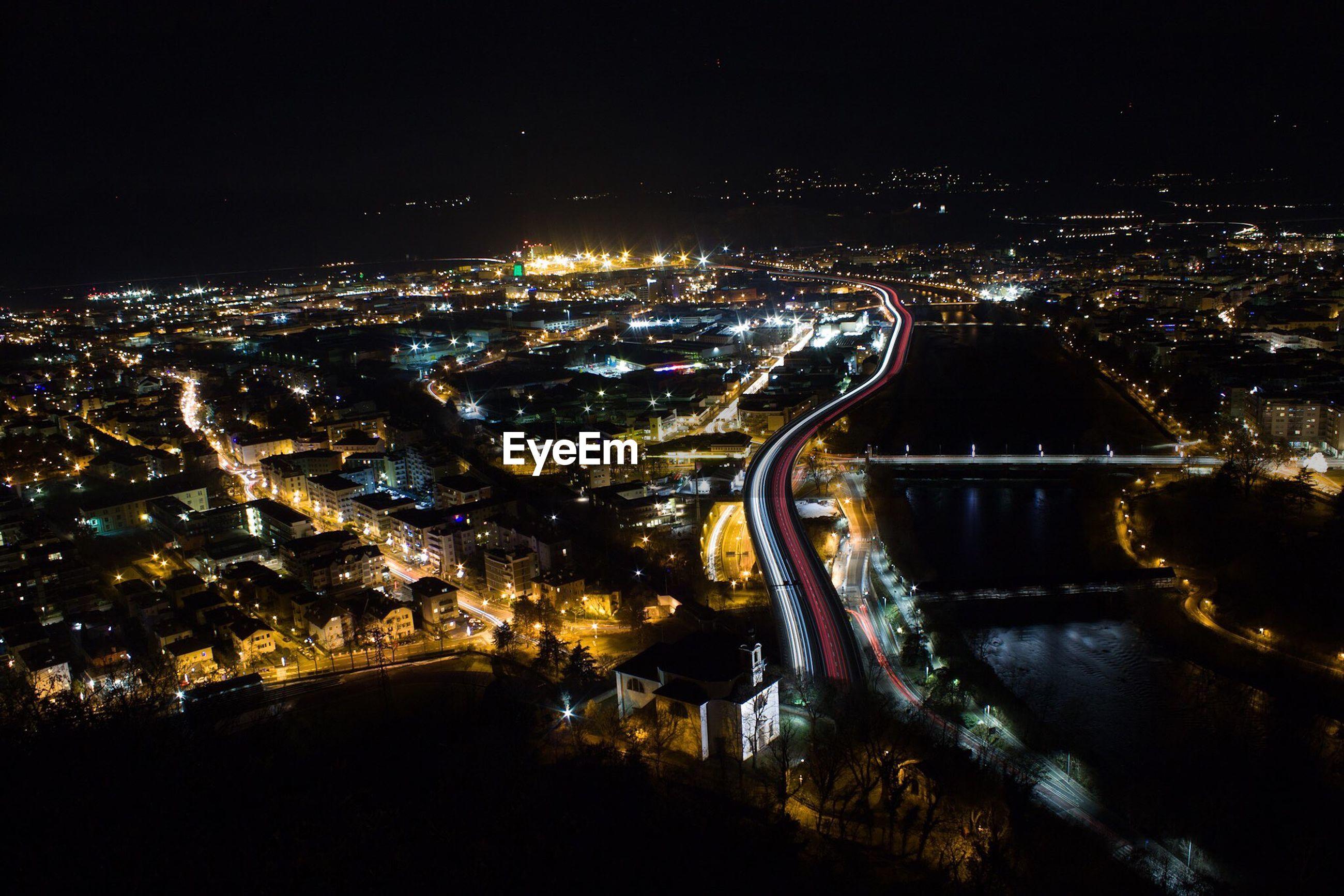 Idyllic view of illuminated cityscape at night