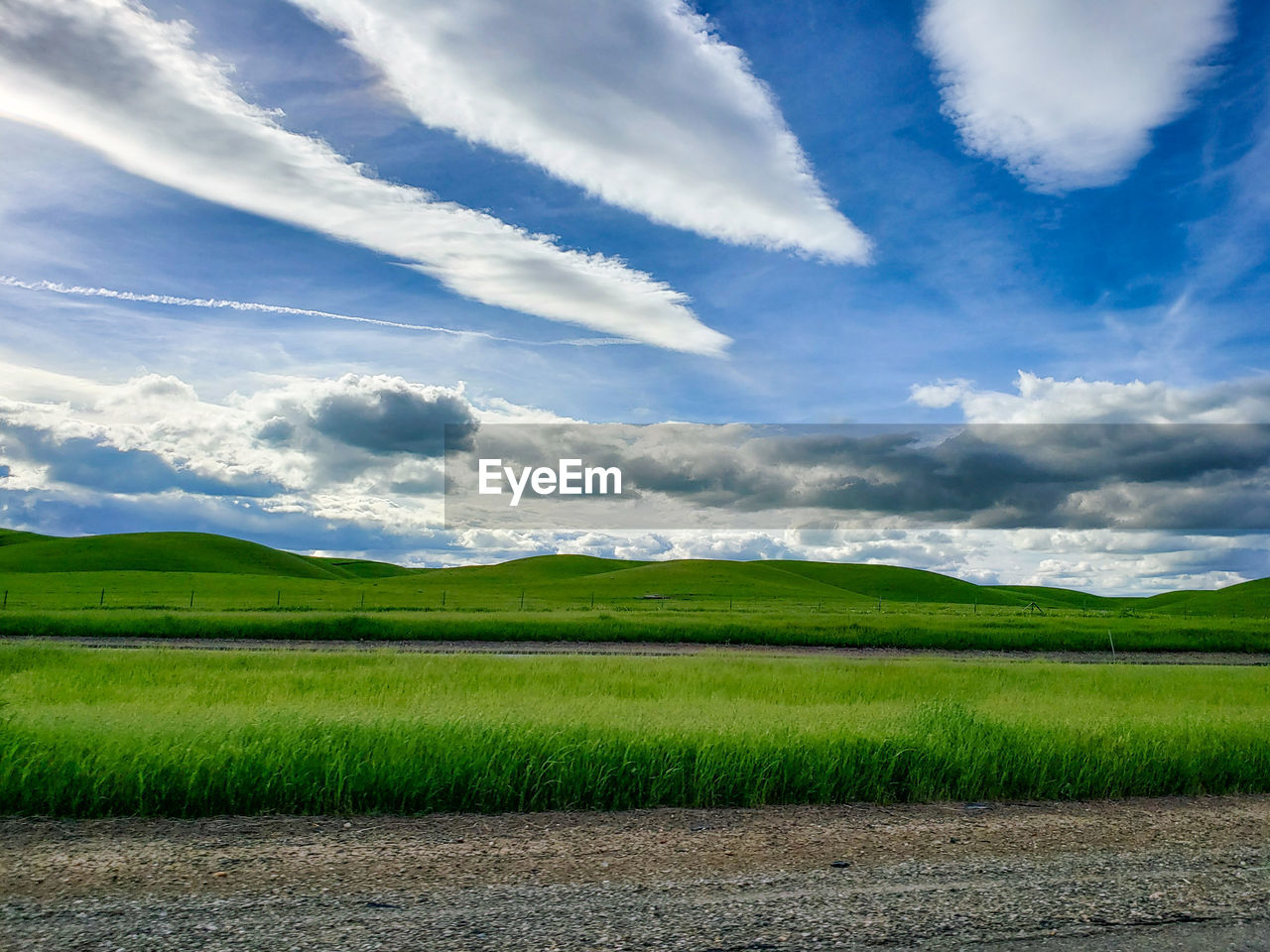 cloud - sky, scenics - nature, tranquil scene, landscape, sky, beauty in nature, environment, tranquility, land, green color, grass, field, day, nature, plant, no people, rural scene, non-urban scene, idyllic, agriculture, outdoors