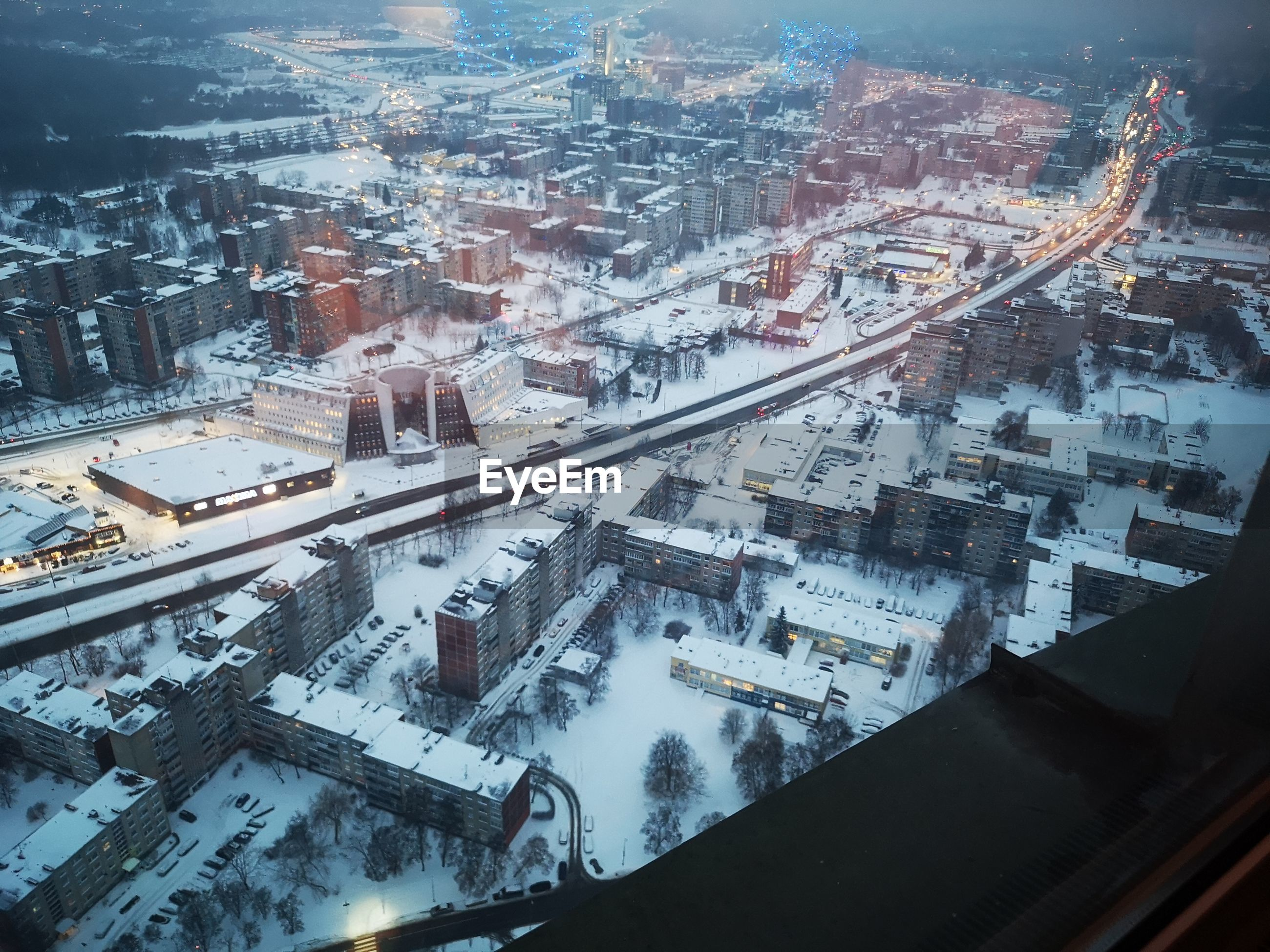 High angle view of buildings in city during winter