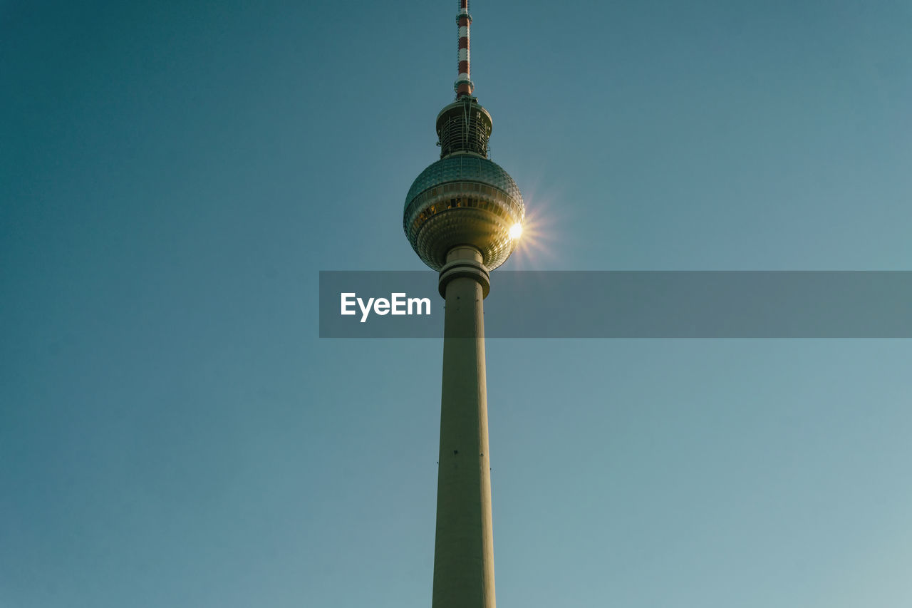 low angle view, sky, clear sky, architecture, tower, tall - high, built structure, technology, copy space, lighting equipment, nature, no people, blue, communication, sphere, tourism, spire, building exterior, day, outdoors, electricity, global communications, turquoise colored, electrical equipment