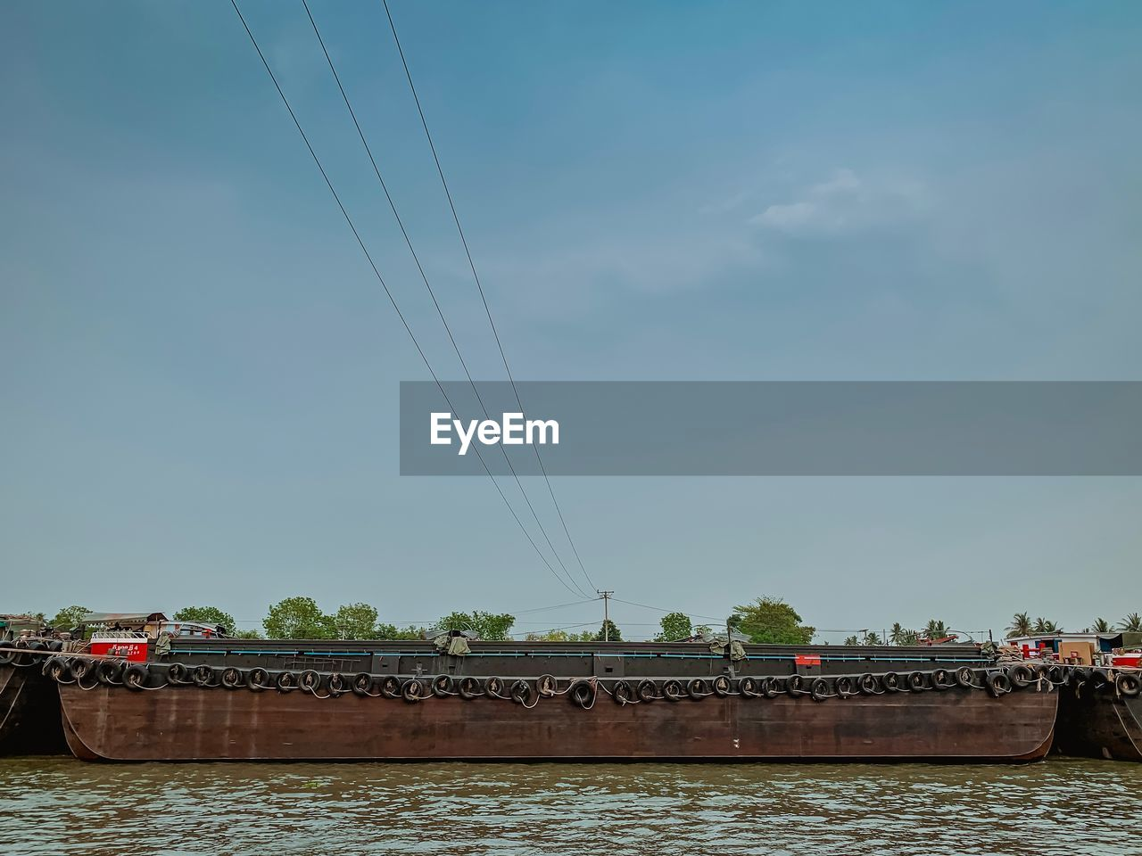 water, transportation, sky, river, connection, nature, architecture, built structure, mode of transportation, cable, bridge, waterfront, electricity, bridge - man made structure, day, nautical vessel, tree, outdoors, no people, power supply
