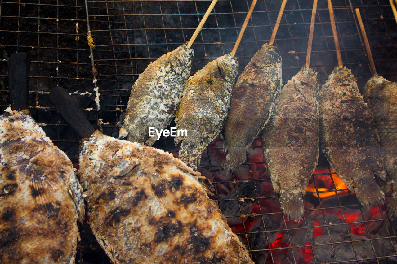 food and drink, food, barbecue, meat, barbecue grill, freshness, heat - temperature, burning, fire, grilled, preparation, close-up, no people, fire - natural phenomenon, healthy eating, indoors, wellbeing, nature, focus on foreground, flame, preparing food, white meat