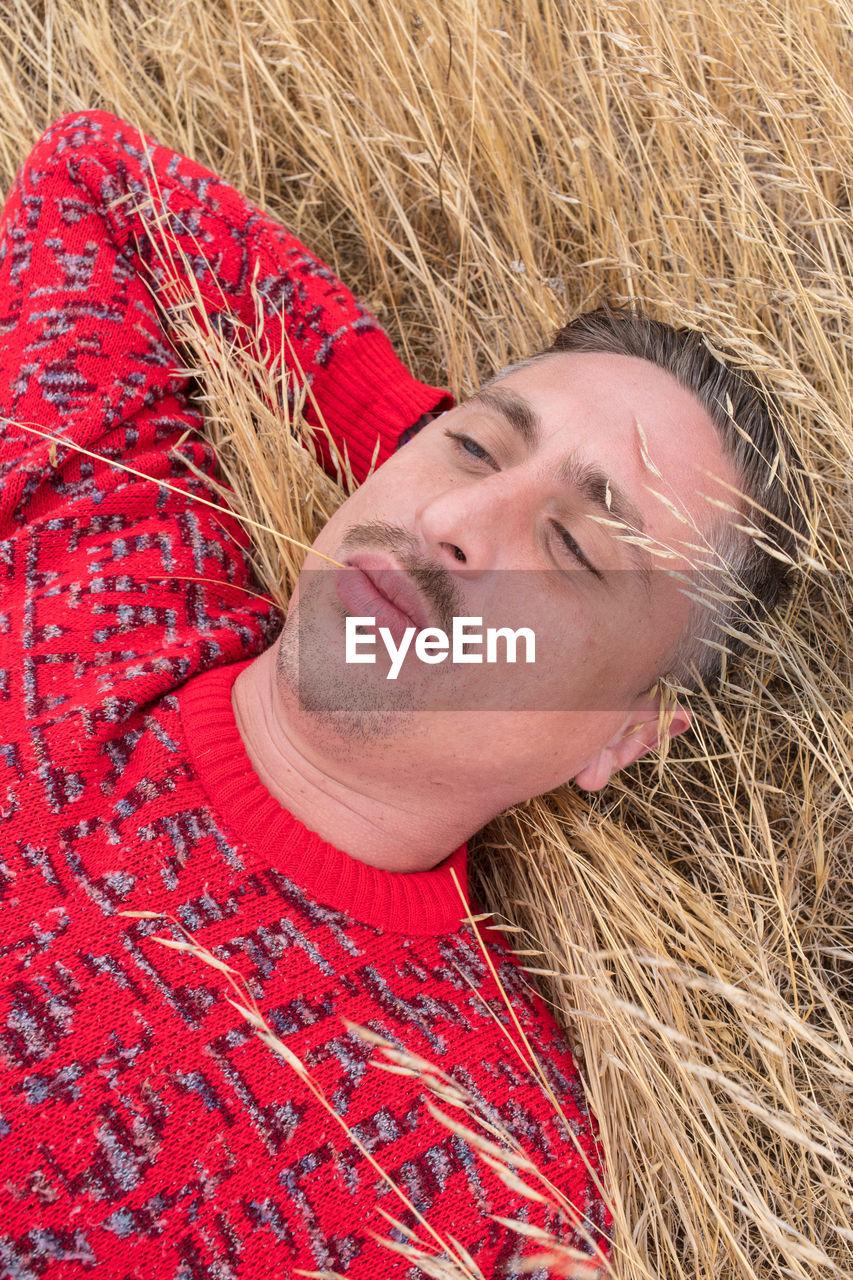 High angle view of man lying on grass