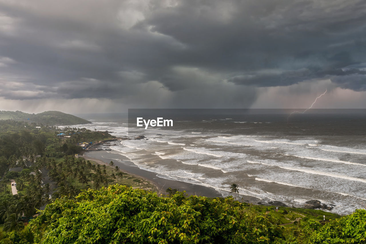 cloud - sky, sky, beauty in nature, sea, nature, scenics - nature, tree, water, plant, storm, land, no people, overcast, day, storm cloud, beach, environment, outdoors, power in nature, ominous