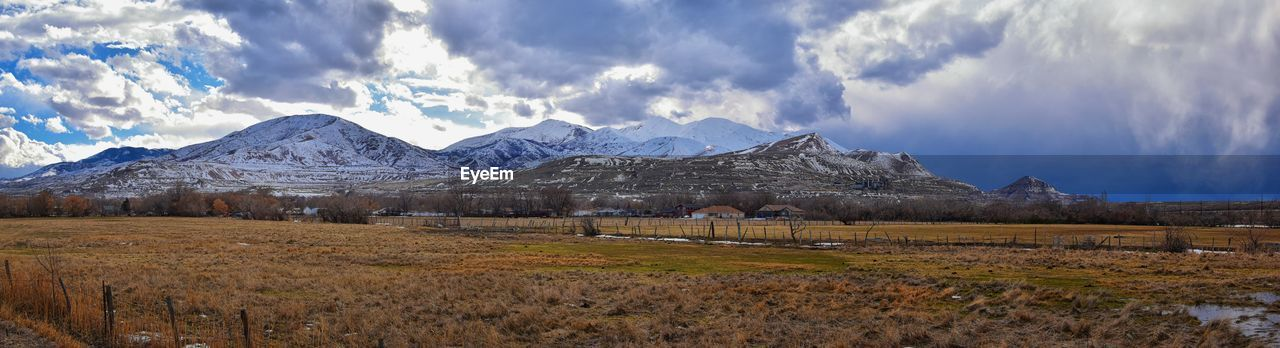 mountain, sky, cloud - sky, scenics - nature, environment, landscape, beauty in nature, nature, tranquil scene, snow, mountain range, cold temperature, tranquility, winter, no people, plant, day, field, land, snowcapped mountain, outdoors, mountain peak