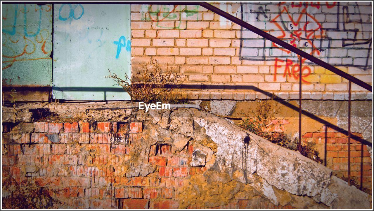 Graffiti On Weathered Wall