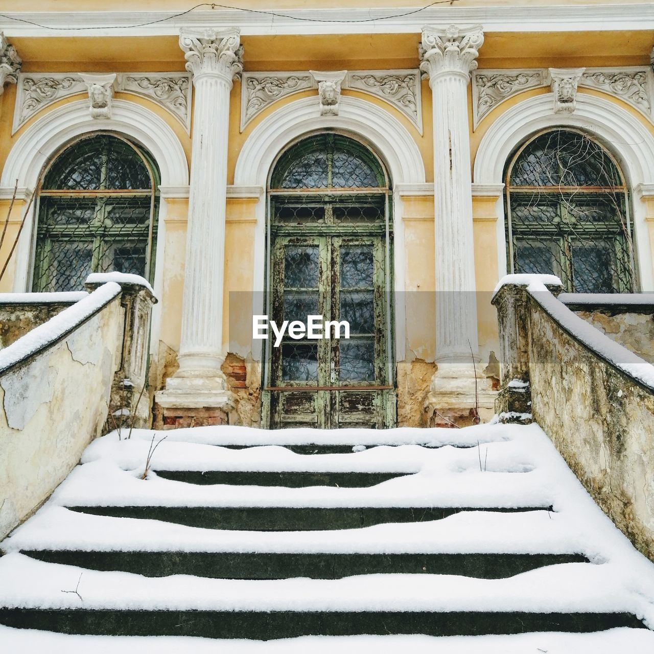 built structure, architecture, building exterior, arch, building, snow, window, no people, winter, cold temperature, day, entrance, door, railing, nature, staircase, outdoors, closed, white color, architectural column