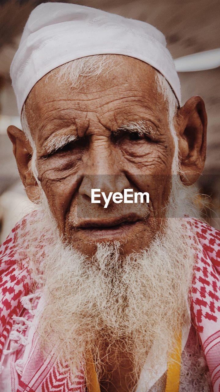 Close-Up Portrait Of Bearded Senior Man