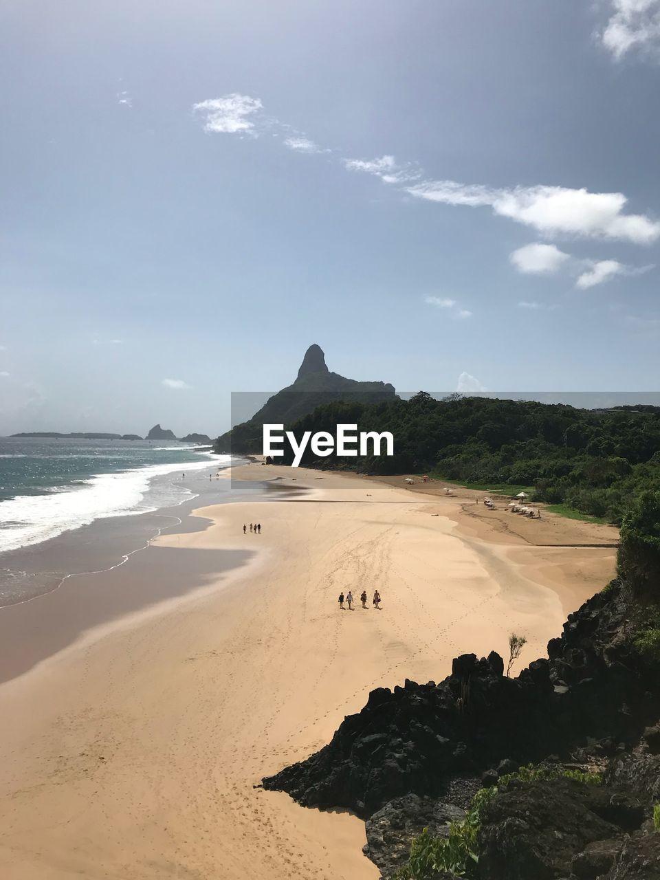 land, sea, beach, water, sky, sand, beauty in nature, scenics - nature, tranquility, nature, tranquil scene, cloud - sky, day, non-urban scene, rock, rock formation, outdoors, idyllic, coastline