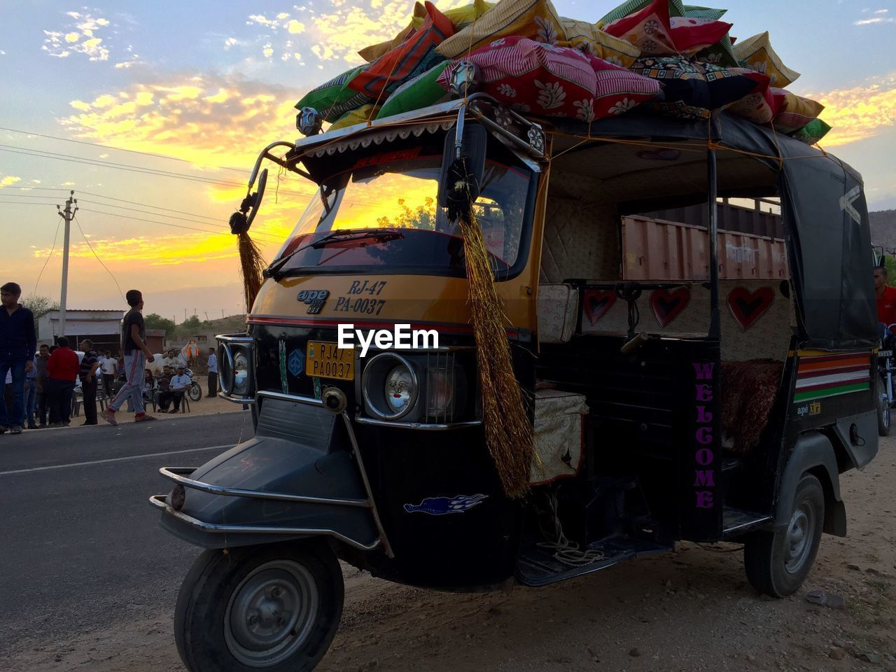 land vehicle, transportation, street, real people, mode of transport, sky, road, outdoors, day, men, people