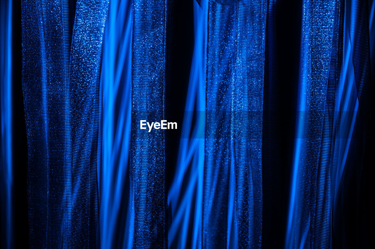 curtain, blue, backgrounds, stage - performance space, textile, no people, arts culture and entertainment, studio shot, hanging, close-up, film industry, indoors, day